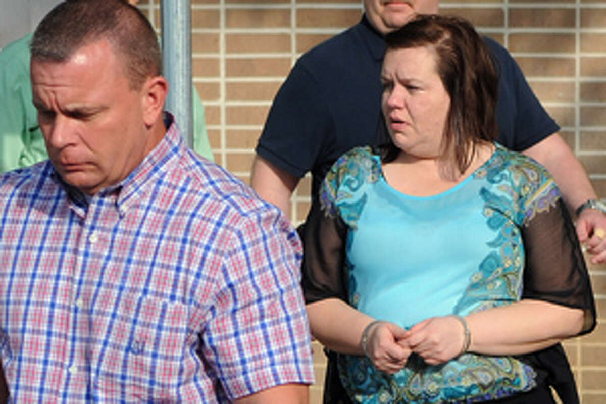 FILE - In this March 30, 2012 file photo, convicted murderer Kimberly Saenz, right, is escorted from the Angelina County Courthouse in Lufkin, Texas. Jurors who convicted 38-year-old East Texas nurse began hearing evidence Monday, April 2, 2012, to decide whether she receives life in prison without the chance of parole or lethal injection.