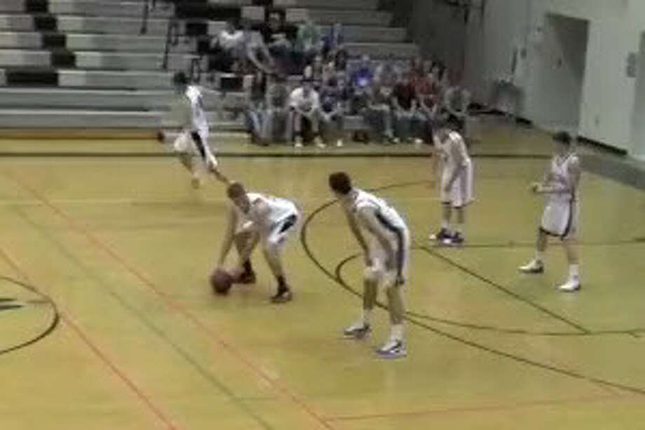 An all-star high school basketball team from the Pride of Iowa Conference confuses its opponents by lining up for a football play, leading to a massive dunk down court.