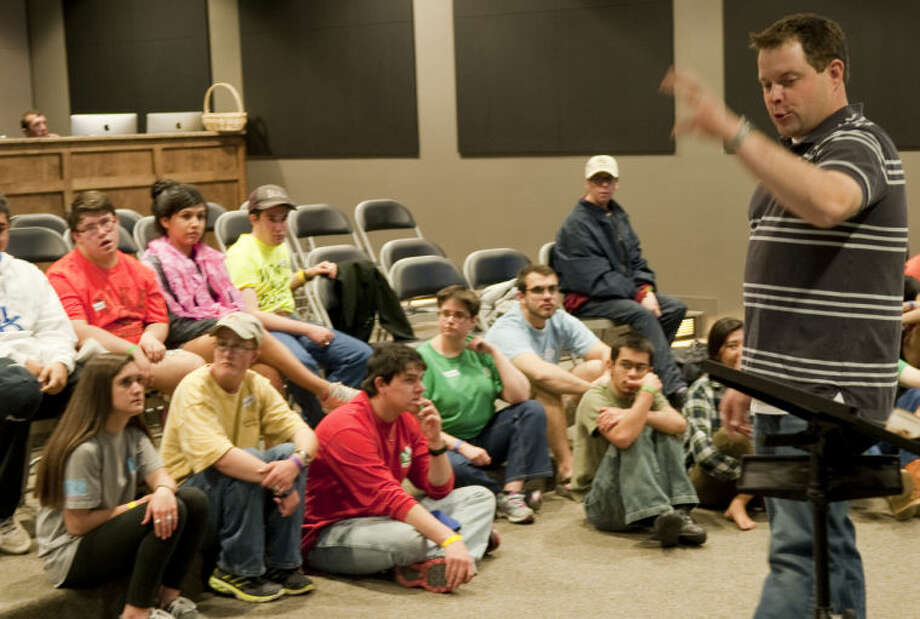 Shane Christopher, special needs coordinator with Young Life, speaks Wednesday during prayer time at Capernaum Young Life Spring Break Camp. Tim Fischer\Reporter-Telegram Photo: Tim Fischer