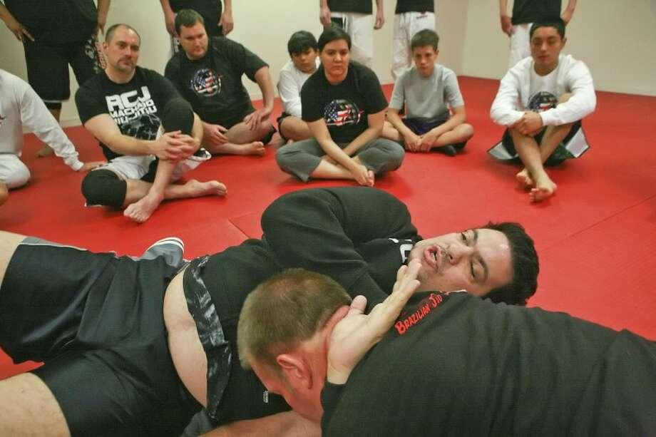 Eight-time Brazilian Jiu-Jitsu champion Rigan Machado demonstrates a D'Arc Choke, Saturday during a Mixed Martial Arts Seminar at Perez Martial Arts studio. Cindeka Nealy/Reporter-Telegram Photo: Cindeka Nealy