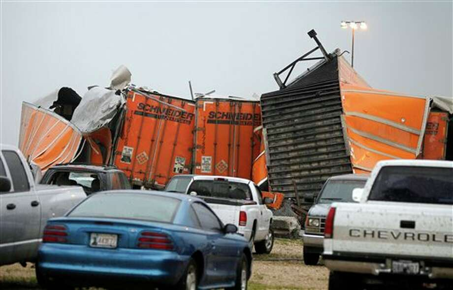 "Trailers lay smashed atop one another after a tornado reportedly tore through the southeastern portion of Dallas County, Texas, Tuesday, April 3, 2012 near Lancaster, Texas. The National Weather Service confirmed at least two separate ""large and extremely dangerous"" tornadoes in the Dallas-Fort Worth area. Several other developing twisters were reported as a band of violent storms moved north through the metropolitan area. Officials had no immediate information about injuries. (AP Photo/The Dallas Morning News, G.J. McCarthy) Photo: G.J. McCarthy / The Dallas Morning News"