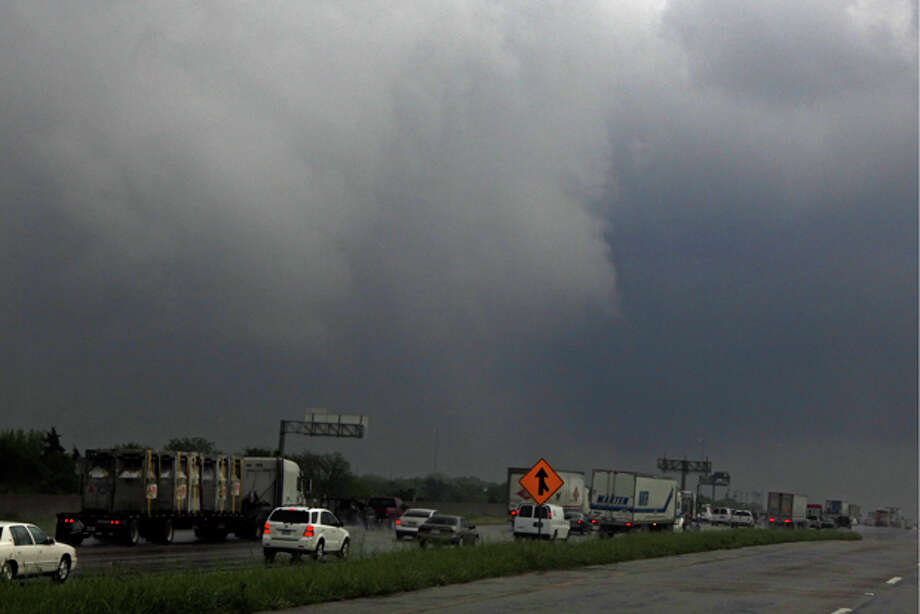 "Cloud rotation moves over I-20 after a tornado reportedly tore through the southeastern portion of Dallas County Tuesday, April 3, 2012 near Lancaster, Texas The National Weather Service confirmed at least two separate ""large and extremely dangerous"" tornadoes in the Dallas-Fort Worth area. Several other developing twisters were reported as a band of violent storms moved north through the metropolitan area. Officials had no immediate information about injuries. (AP Photo/The Dallas Morning News, G.J. McCarthy) Photo: G.J. McCarthy / The Dallas Morning News"