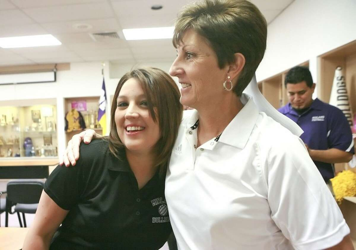 Amanda Lopez, left, embraces former head coach Terri McColloch after Loepz was announced the new head volleyball coach, pending school board approval, Monday at Midland High School. Cindeka Nealy/Reporter-Telegram
