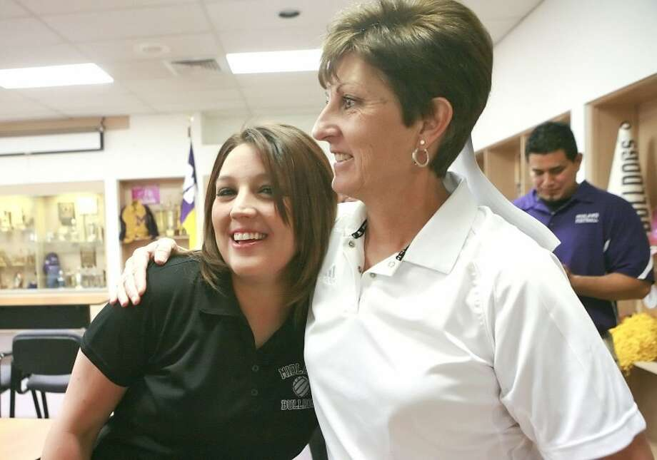 Amanda Lopez, left, embraces former head coach Terri McColloch after Loepz was announced the new head volleyball coach, pending school board approval, Monday at Midland High School. Cindeka Nealy/Reporter-Telegram Photo: Cindeka Nealy