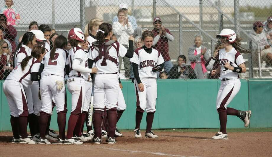 Ciara Sheppard is greeted by her teammates after hitting a solo homerun during their game against Odessa High last season at the Gene Smith Softball Field. Sheppard hit a solo home run in Lee's 4-2 victory against No. 1 Lubbock Coronado on Tuesday. Cindeka Nealy/Reporter-Telegram Photo: Cindeka Nealy