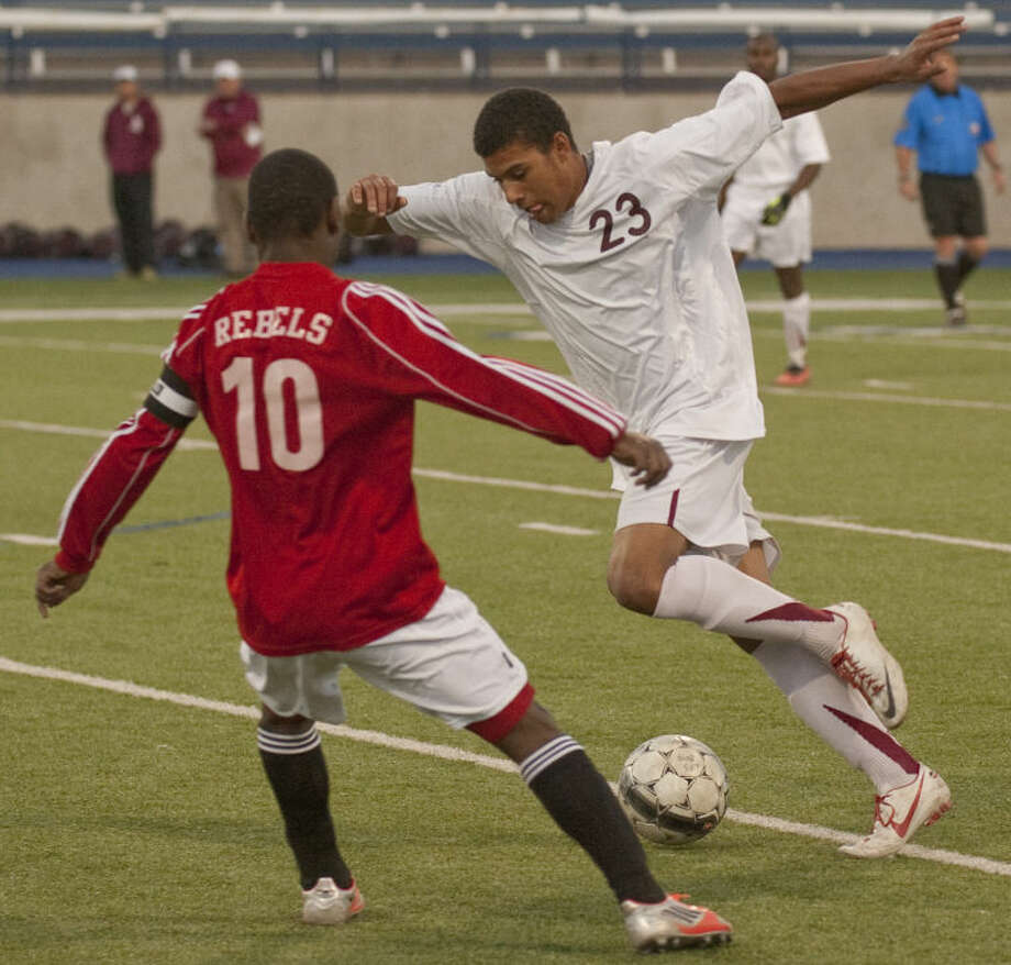 Lee High's Alex Bell tries to get around Tascosa's Mustaf Magano on Tuesday evening at Grande Communications Stadium. Tim Fischer\Reporter-Telegram Photo: Tim Fischer