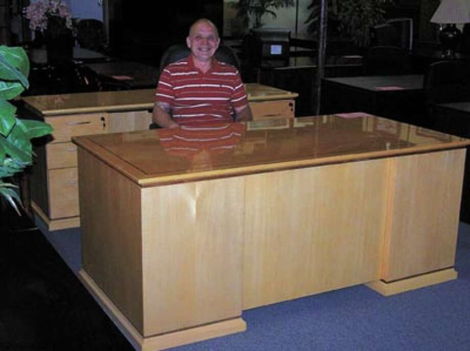 Need a top quality, solid maple desk like this one? It and a showroom full of office furniture are on sale now at A-1 Office Furniture, says general manager Steve Ausmus. A-1 is in the big yellow building at Industrial and Marienfeld in downtown Midland.