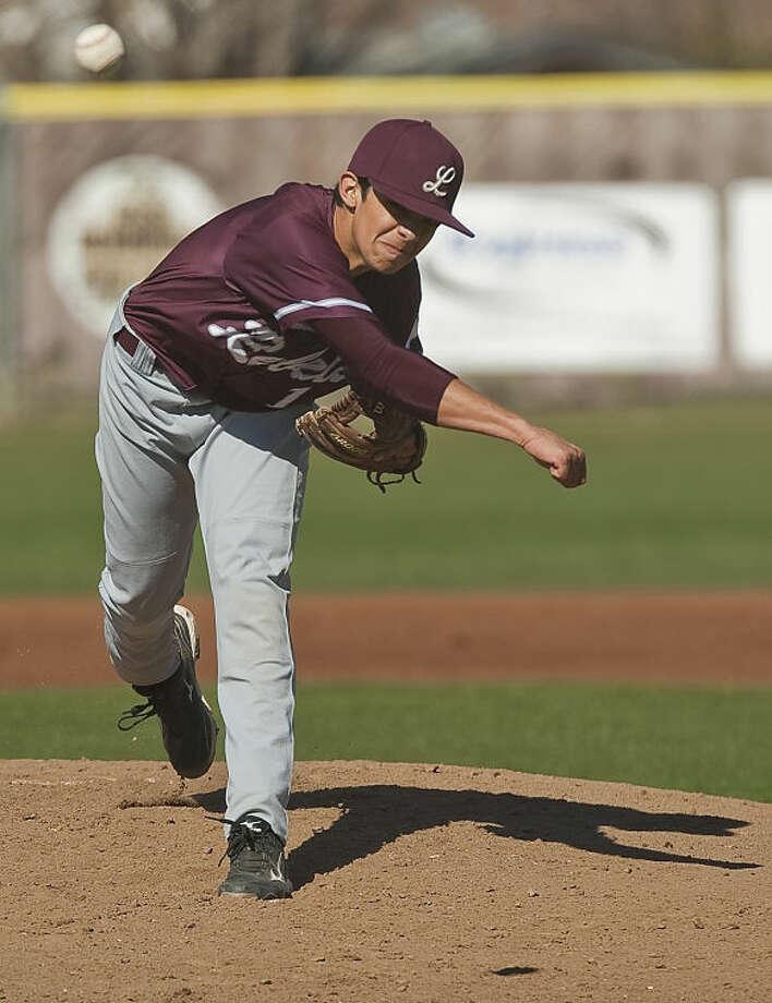 Lee High's Evan Mata delivers a pitch Tuesday afternoon at Ernie Johnson Field against Abilene High. Tim Fischer\Reporter-Telegram Photo: Tim Fischer