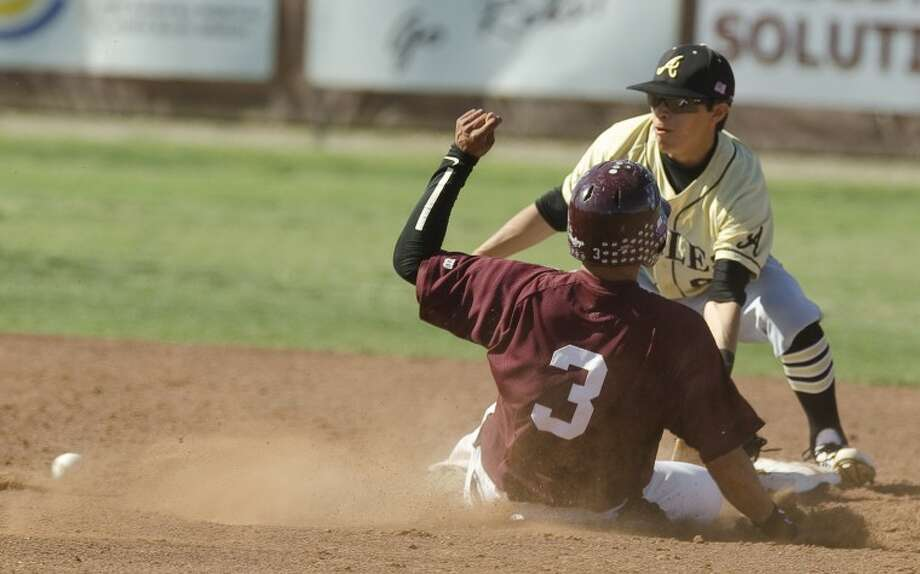 Midland Lee's #3 safely slides into second for a steal as Abilene High's #8 waits om the ball Tuesday afternoon at LHS. Photo by Tim Fischer/Midland Reporter-Telegram Photo: Tim Fischer