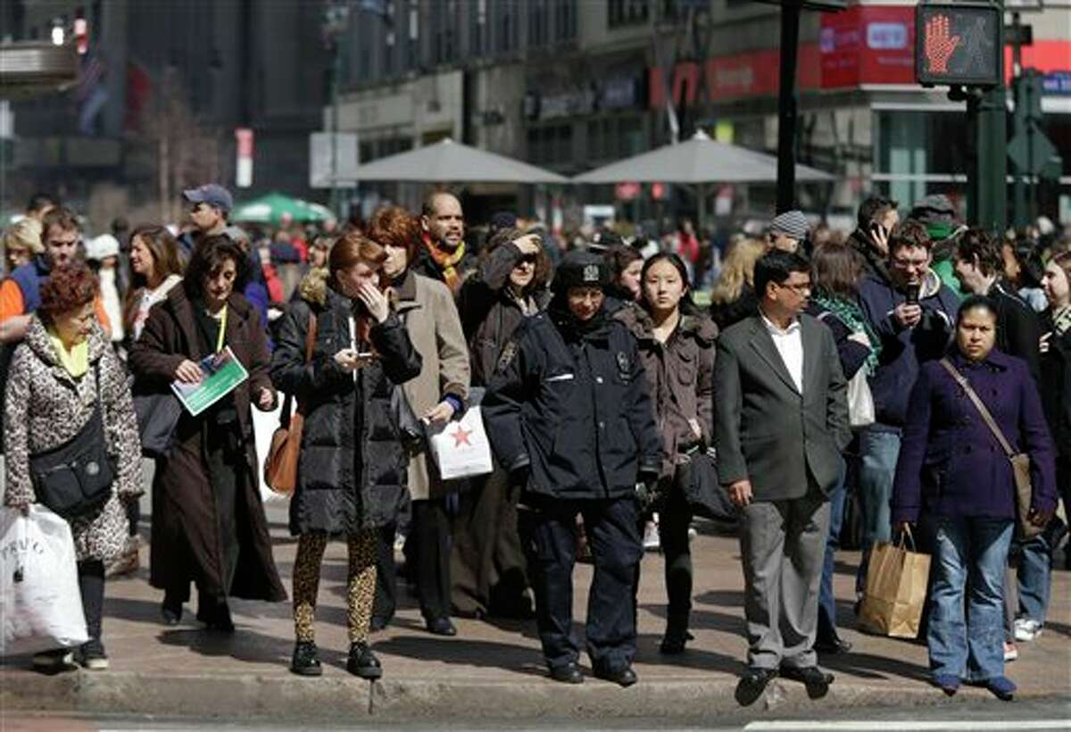 ** ADVANCE FOR USE AFTER 12:01 A.M. EDT ON MONDAY, MARCH 18 ** In this photo taken March 13, 2013, pedestrians wait to cross a New York street. An historic decline in the number of U.S. whites and the fast growth of Latinos are blurring traditional black-white color lines in the U.S. The demographic shift is now a potent backdrop to an immigration overhaul bill, being debated in Congress, that could offer a path to citizenship for 11 million mostly Hispanic illegal immigrants. (AP Photo/Seth Wenig)