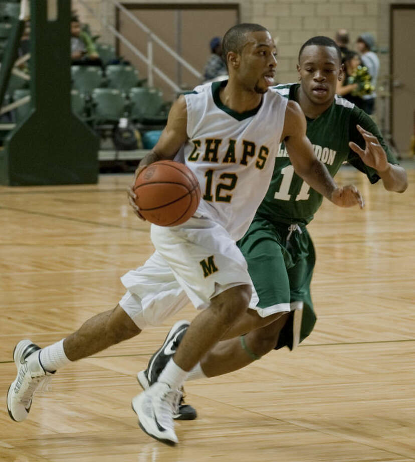 Midland College's Corey Hilliard brings the ball downcourt as Clarendon's Hershell Grant defends Monday night at the Chaparral Center. Tim Fischer\Reporter-Telegram Photo: Tim Fischer