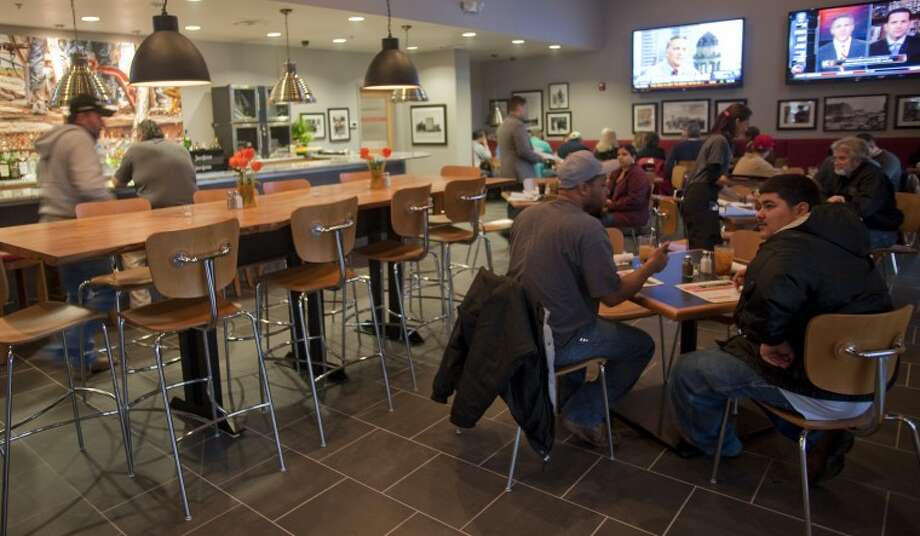 (File Photo) Patrons sit in the bar area during the opening day lunch hour at Basin Burger House. Tim Fischer\Reporter-Telegram Photo: Tim Fischer