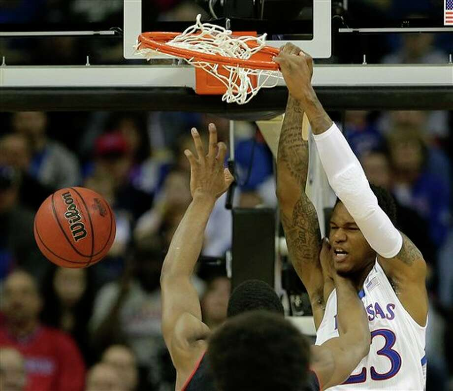 Kansas guard Ben McLemore (23) dunks the ball during the first half an NCAA college basketball game against Texas Tech in the Big 12 men's tournament Thursday, March 14, 2013, in Kansas City, Mo. (AP Photo/Charlie Riedel) Photo: Charlie Riedel / AP