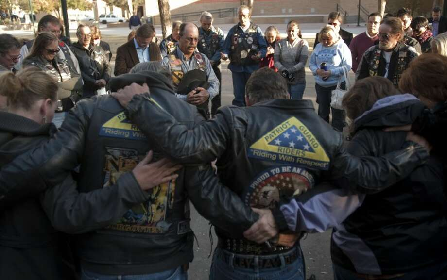 (File Photo) Patriot Guard riders gather Friday morning as Ride Captain, Ductape, leads them in prayers for the victims and their families of the veterans parade accident. Tim Fischer\Reporter-Telegram Photo: Tim Fischer