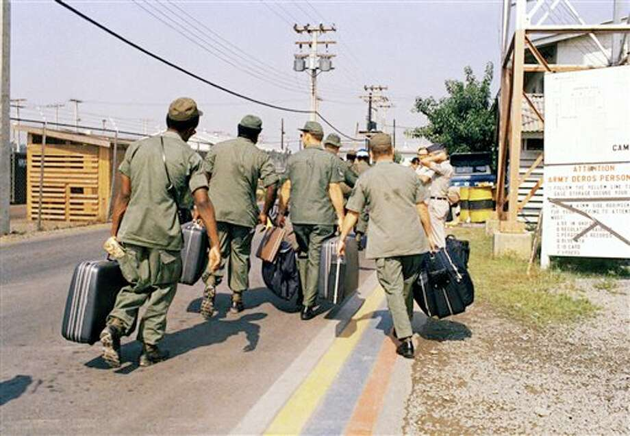 In this March 29, 1973 photo, Camp Alpha, Uncle Sam's out processing center, was chaos in Saigon. Lines of bored soldiers snaked through customs and briefing rooms. As the last U.S. combat troops left Vietnam 40 years ago, angry protesters still awaited them at home. North Vietnamese soldiers took heart from their foes' departure, and South Vietnamese who had helped the Americans feared for the future. While the fall of Saigon two years later — with its indelible images of frantic helicopter evacuations — is remembered as the final day of the Vietnam War, Friday marks an anniversary that holds greater meaning for many who fought, protested or otherwise lived it. (AP Photo) Photo: STF / AP