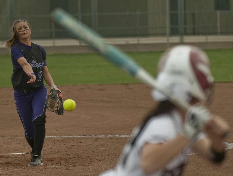 Midland High's Stefani Baeza delivers a pitch to Lee's Kylee Olivas on Saturday at Gene Smith Field on March 9. Tim Fischer\Reporter-Telegram Photo: Tim Fischer