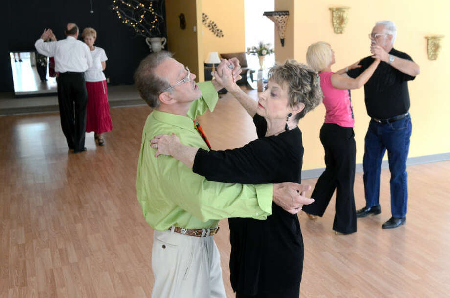 Fred Behmardi, owner, dances with Reesie Petree on Friday at Elegance Ballroom in the Colonade Shopping Center. James Durbin/Reporter-Telegram Photo: JAMES DURBIN