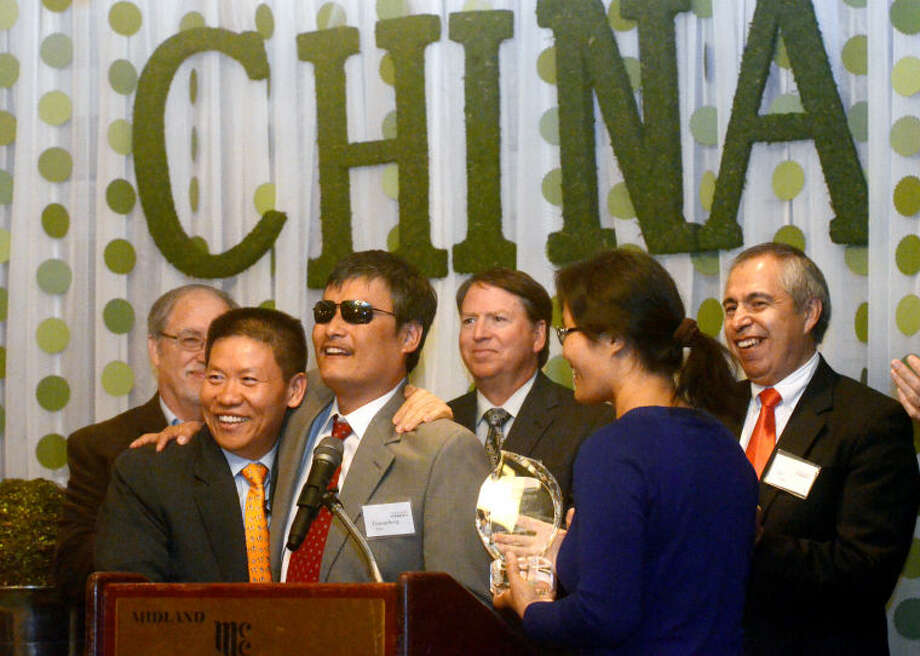 Bob Fu, founder of China Aid, presents Chen Guangcheng with an award during the China Aid banquet Tuesday at Midland Country Club. James Durbin/Reporter-Telegram Photo: JAMES DURBIN