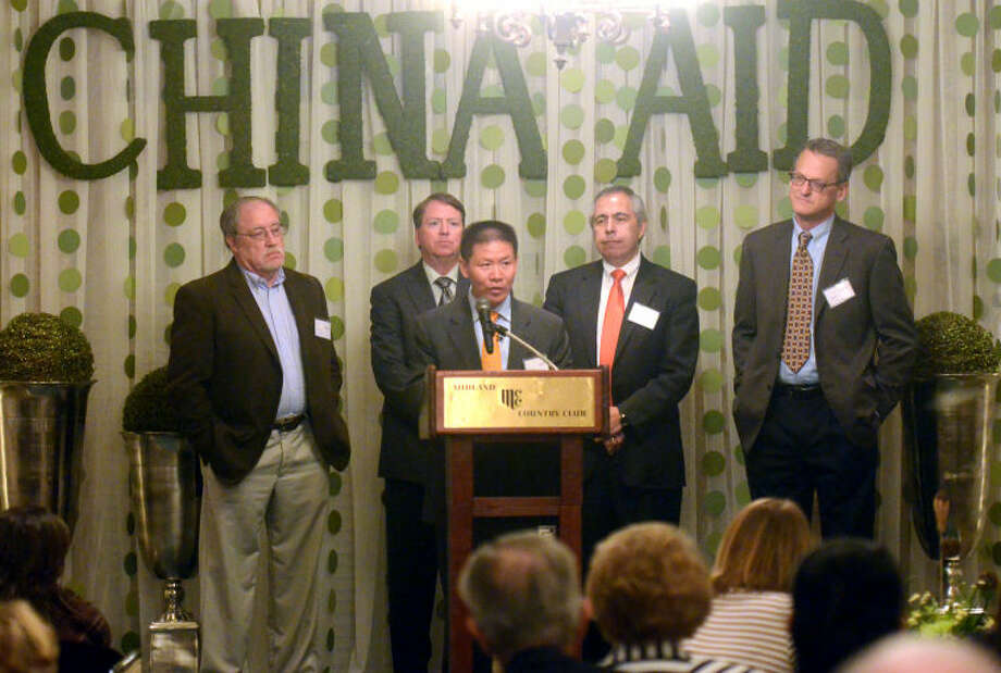 Bob Fu, founder of China Aid, stands with China Aid board members during the China Aid banquet Tuesday at Midland Country Club. James Durbin/Reporter-Telegram Photo: JAMES DURBIN
