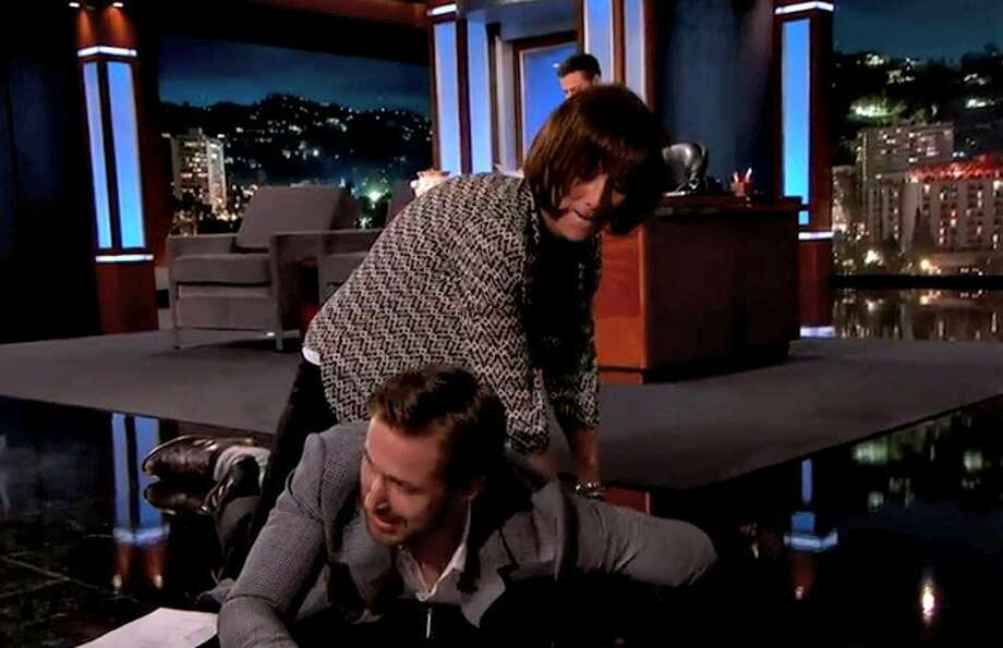 Ryan Gosling Grabs Kimmel Audience Member To Act Out The border=