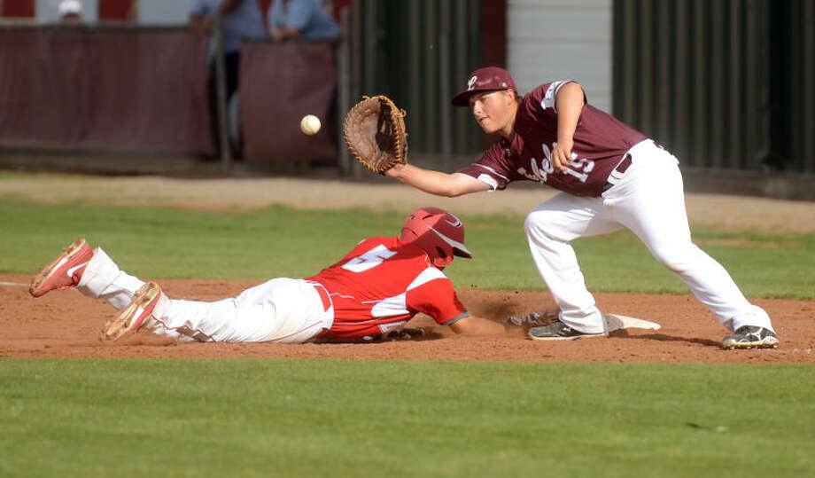 Lee's Austin Maddox tries to catch Odessa's John Rodriguez off base Friday at Ernie Johnson Field. James Durbin/Reporter-Telegram Photo: JAMES DURBIN