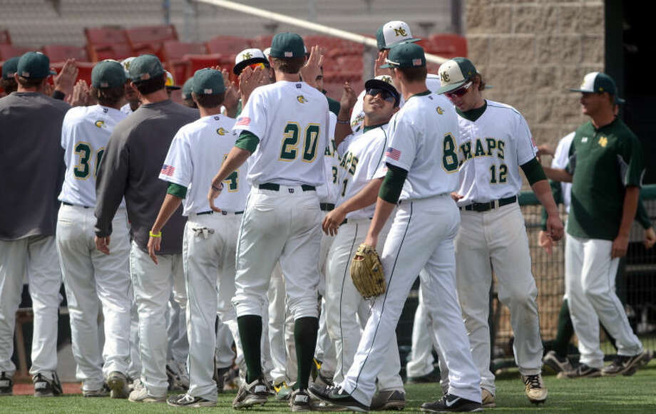 The Midland College baseball team celebrates after beating El Paso in the first game of a doubleheader Friday at Christensen Stadium. James Durbin/Reporter-Telegram Photo: JAMES DURBIN