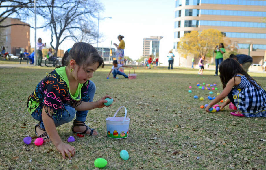 Five-year-old Alina Salgado participates in an Easter egg hunt put on by the Harvest Time Church during the Easter at the Plaza event Saturday at Centennial Plaza. Rene Valdez, an usher at the church, estimated that about 3,500 eggs were used in the hunt. James Durbin/Reporter-Telegram Photo: JAMES DURBIN
