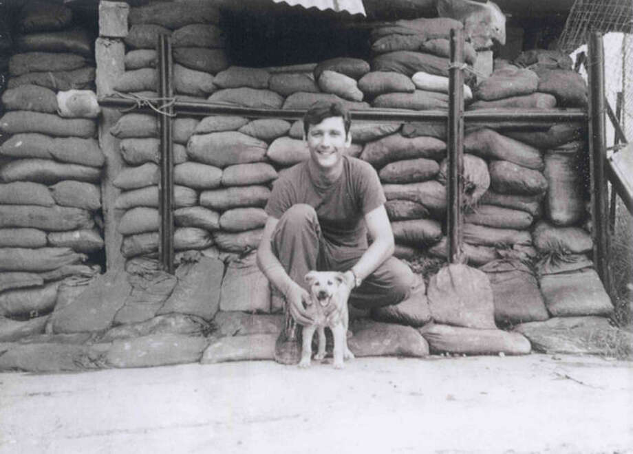 "U.S. Army Staff Sergeant Sonny Turner with ""Oscar"" at a bunker in Vietnam. 1972"