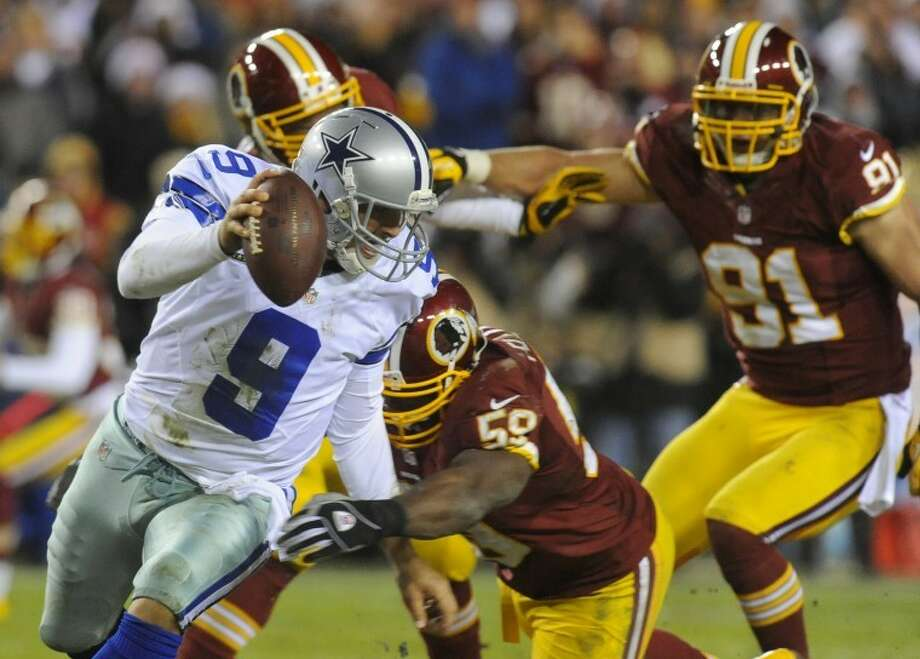 Dallas Cowboys quarterback Tony Romo (9) is sacked by Washington Redskins inside linebacker London Fletcher (59) during the second half of an NFL football game Sunday, Dec. 30, 2012, in Landover, Md. The Redskins won 28-18, securing a playoff berth. (AP Photo/Richard Lipski) Photo: Richard Lipski