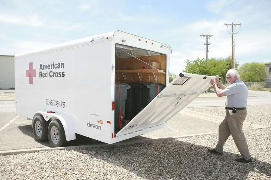American Red Cross of Southwest Texas interim Executive Director Randy Weddle closes the gate on one of three new trailers the organization will use to transport bedding and comfort kits to areas affected by a man-made or natural disaster. Each trailer will be equipped with enough cots, pillows, blankets and hygiene products to supply 100 people.  Photo: Cindeka Nealy /Reporter-Telegram
