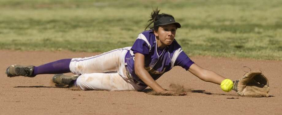 Midland High's Naomi Posada dives for a grounder up the middle Thursday against Odessa High. Photo by Tim Fischer/Midland Reporter-Telegram Photo: Tim Fischer