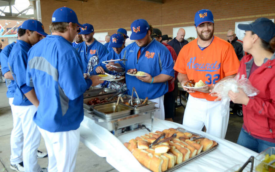 """Rockhounds players go through the food line during the Rockhounds """"meet the team"""" barbeque Tuesday at Citibank Ballpark. James Durbin/Reporter-Telegram Photo: JAMES DURBIN"""