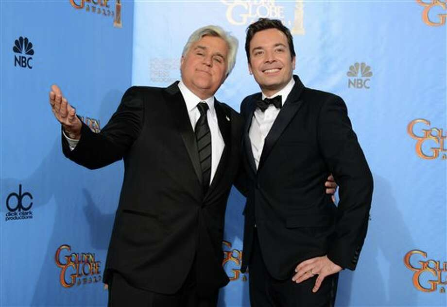 "FILE - This Jan. 13, 2013 file photo shows Jay Leno, host of ""The Tonight Show with Jay Leno,"" left, and Jimmy Fallon, host of ""Late Night with Jimmy Fallon"" backstage at the 70th Annual Golden Globe Awards in Beverly Hills, Calif. Leno and Jimmy Fallon poked fun at the late-night rumors swirling around them in a music video that aired between their back-to-back NBC shows on Monday, April 1. In a spoof of the romantic ballad ""Tonight"" from ""West Side Story,"" Leno, who was backstage at the ""Tonight"" show on the West Coast, and Fallon, in his ""Late Night"" office in Manhattan, serenaded each other by cellphone. (Photo by Jordan Strauss/Invision/AP, file) Photo: Jordan Strauss / A20132013"