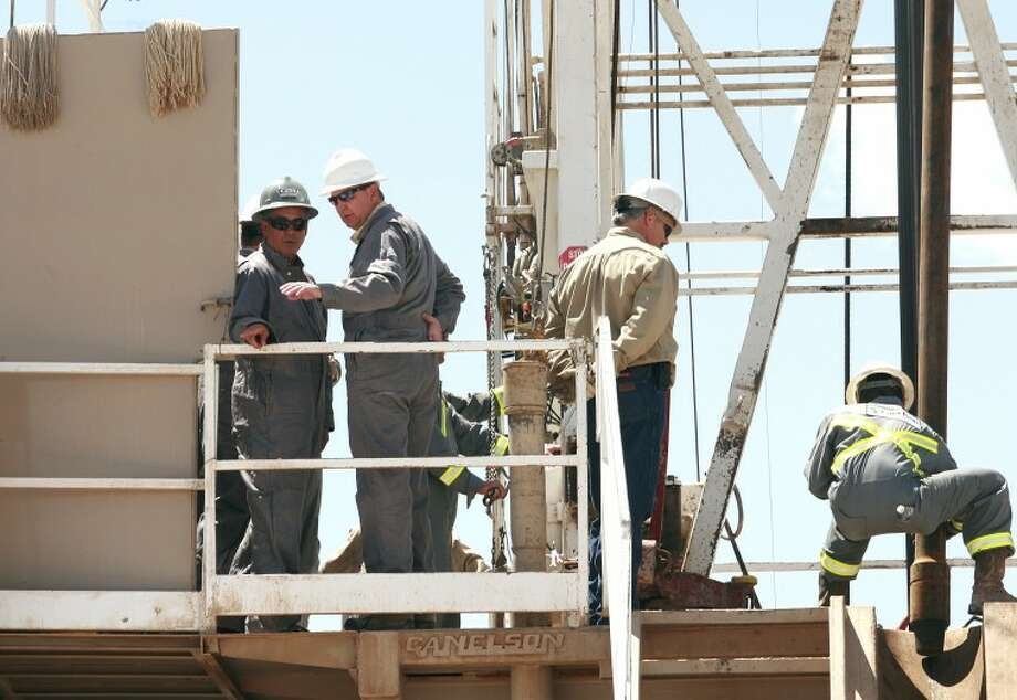 U.S. House Speaker John Boehner, left, listens as Drilling Manger Tommy Taylor talks about rig operations Tuesday during Boehner's tour of Faskin Oil and Ranch drilling rig located off of County Road 40 near 1788 in Midland County. Cindeka Nealy/Reporter-Telegram Photo: Cindeka Nealy