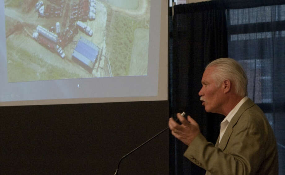 Hoxie Smith, with Midland College, gives a little background on the oil and gas industry in the Permian Basin Tuesday at the Permian Basin Coalition meeting. Tim Fischer\Reporter-Telegram Photo: Tim Fischer