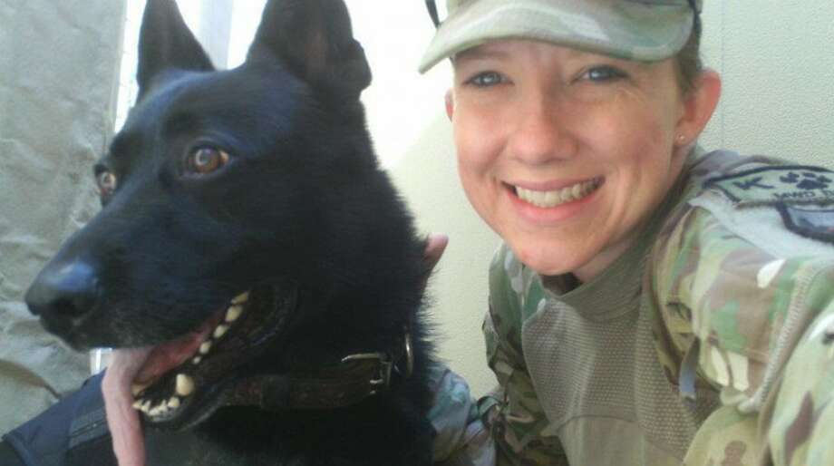 Native Midlander Staff Sgt. Samantha Navarette is a military dog handler stationed at Andrews Air Force Base in Maryland. Navarette and her canine partner, Besy, recently returned from a deployment in Afghanistan. Photo: Courtesy Photo