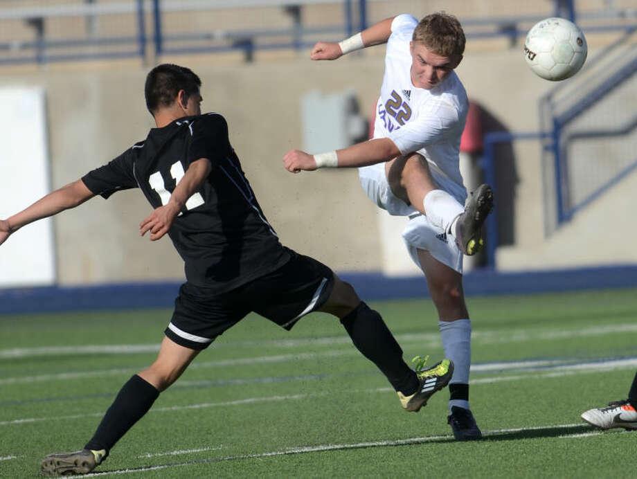 Midland's Jason Carter kicks over El Paso Bel Air's Edgar Salcido during the bi-district playoff game Thursday at Grande Communications Stadium. James Durbin/Reporter-Telegram Photo: JAMES DURBIN