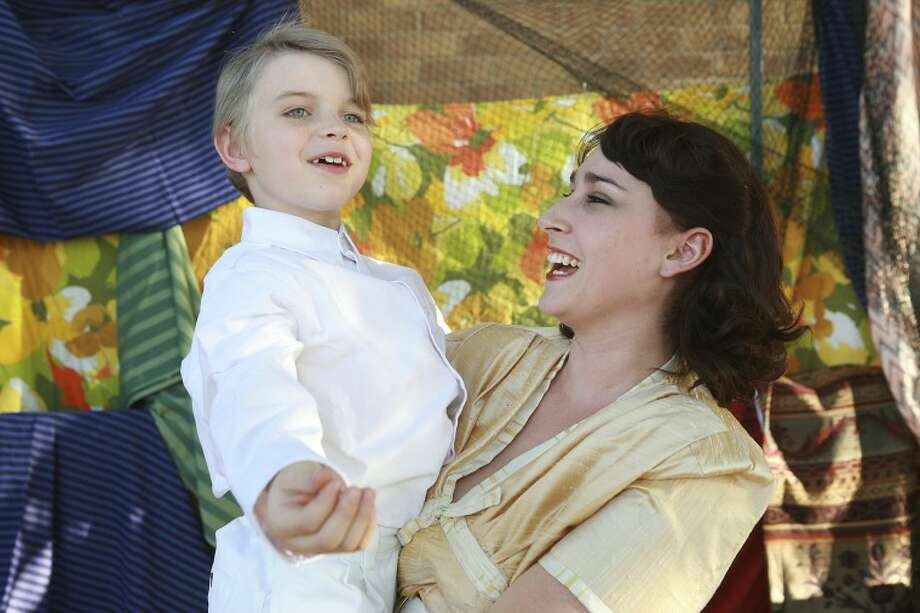 "Four-year-old Tommy (Gabriel Dameron) wishes Mrs. Walker (Emily Bourland) a Happy Birthday, during Midland Community Theatre's production of ""Tommy."" Cindeka Nealy/Reporter-Telegram Photo: Cindeka Nealy"
