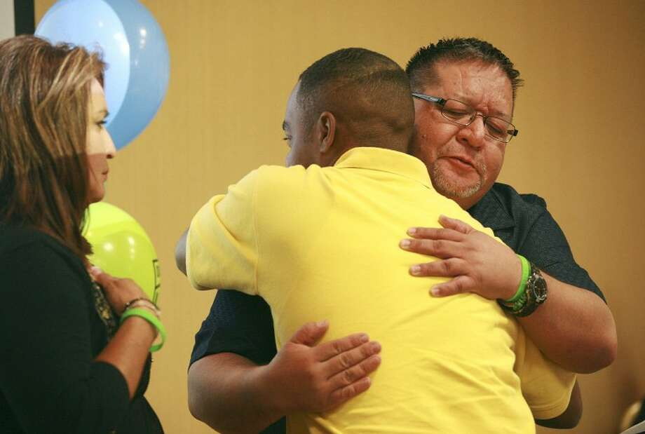 Alex Gutierrez and Keenan Alexander embrace as they meet for the first time Saturday at the Celebration of Giving and Living event at the Holiday Inn Express Hotel and Suites in Odessa. Gutirrez's daughter Loren died as a result of her injuries in a 2011 car accident and Alexander received her kidney and pancreas. Cindeka Nealy/Reporter-Telegram Photo: Cindeka Nealy