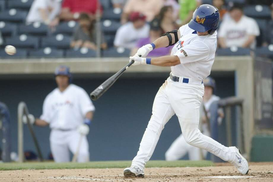 RockHounds second baseman Conner Crumbliss hits a single Saturday night during the Hounds game against Arkansas at Citibank Ballpark. Cindeka Nealy/Reporter-Telegram Photo: Cindeka Nealy