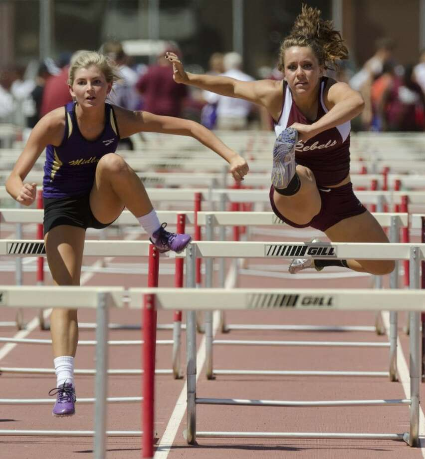 Midland High's Arial Armstrong and Midland Lee's Alyssa Edgerton compete in the girls 100 meter hurdles Friday at the 3-AAAAA district meet at Memorial Stadium. Photo by Tim Fischer/Midland Reporter-Telegram Photo: Tim Fischer