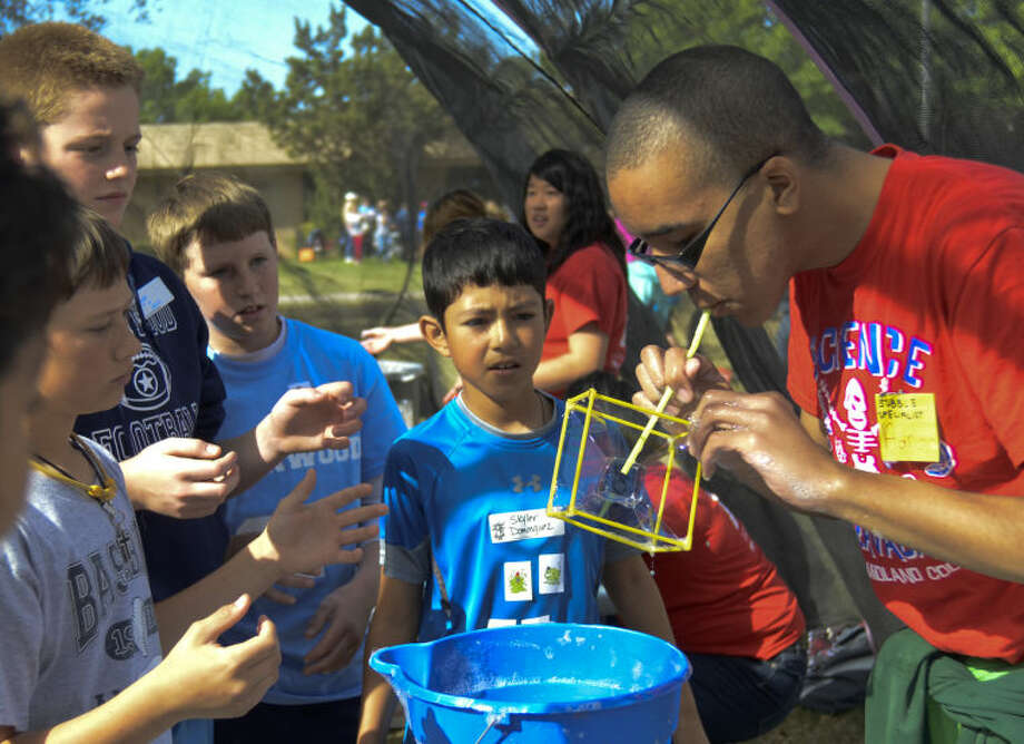 Adrian Rose, MC Early College High School student, demonstrates bubble fun Friday at Midland College Science Extravaganza. Tim Fischer\Reporter-Telegram 4-12-13 Photo: Tim Fischer
