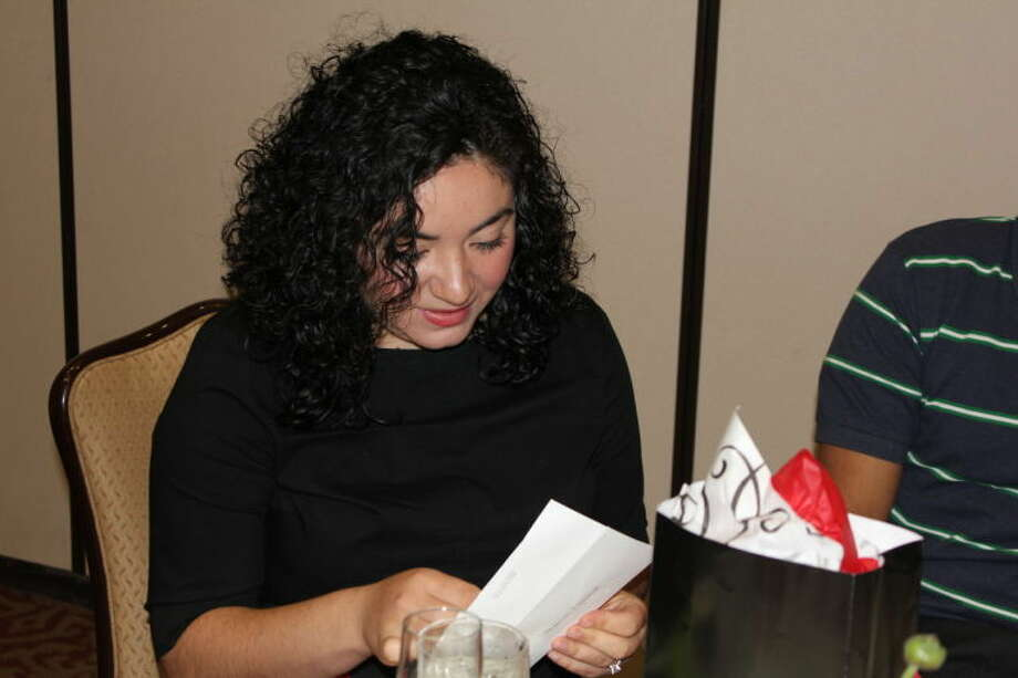 Texas Tech University Health Sciences Center medical student Stephanie Villarreal opens an envelope which contains the destination of her residency in pediatrics at 11 a.m. Friday at the Odessa Country Club. Villarreal learned she will complete her residency at the Texas Tech University Health Sciences Center in Lubbock. Match Day is celebrated at the 137 U.S. medical schools accredited by the Liaison Committee on Medical Education. Photo: Meredith Moriak/Reporter-Telegram