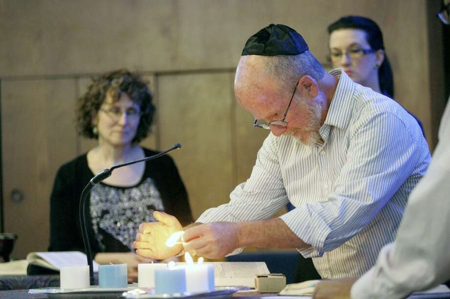 Members of Temple Beth-El light candles as they remember the approximately six million Jews who perished in the Holocaust, Wednesday during Yom HaShoah (the day of the Holocaust). Cindeka Nealy/Reporter-Telegram Photo: Cindeka Nealy