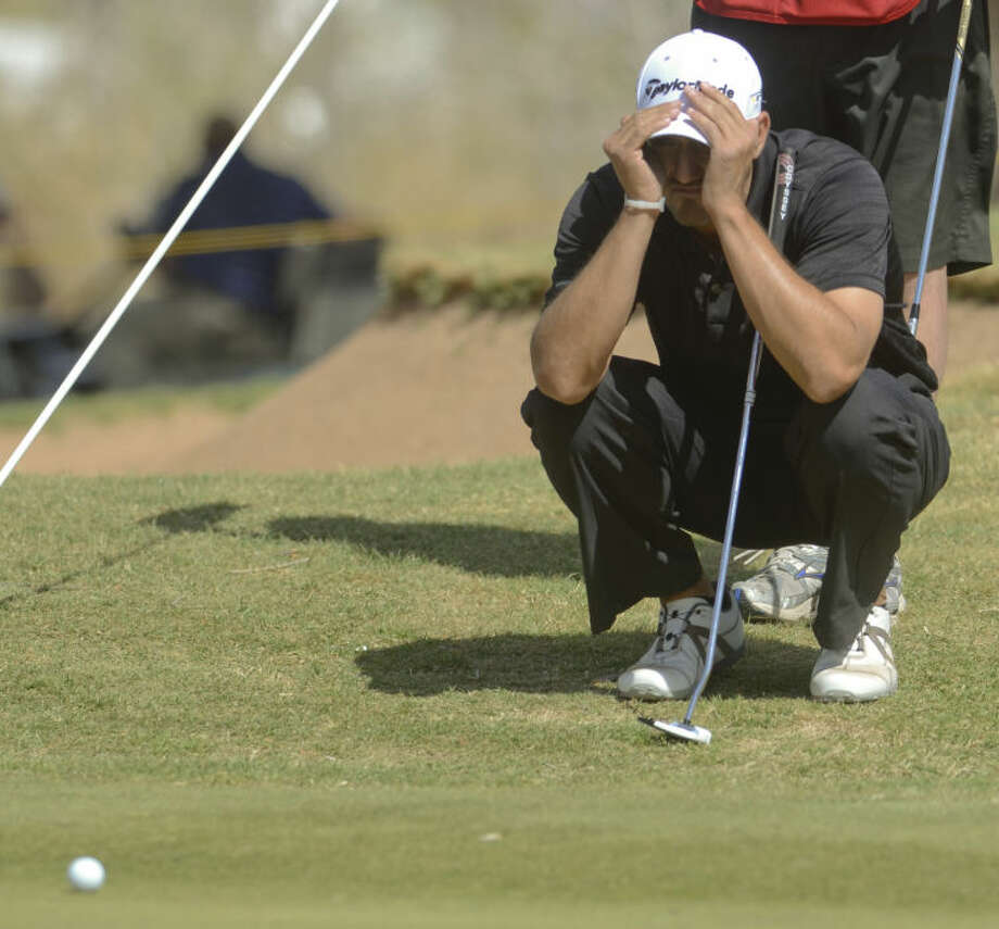 Alex Aragon, winner of the 2013 WNB Golf Classic at Midland Country Club, examines a putt Sunday during the final round of play. Tim Fischer\Reporter-Telegram Photo: Tim Fischer