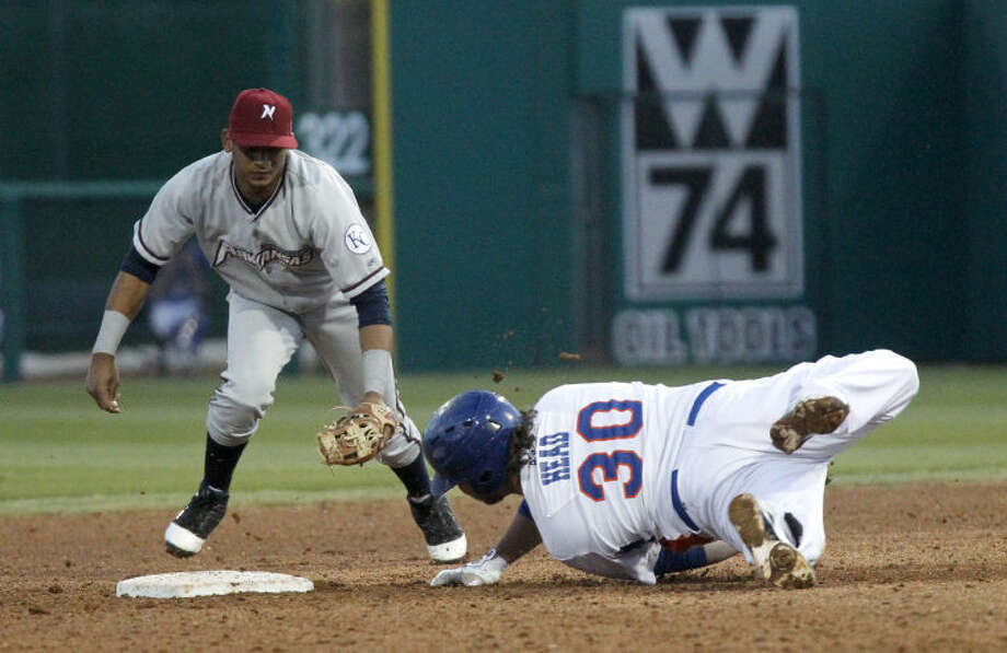 RockHounds' Miles Head slides into second beating the tag from Northwest Arkansas' Angel Franco Friday at Citibank Ballpark. James Durbin/Reporter-Telegram Photo: JAMES DURBIN