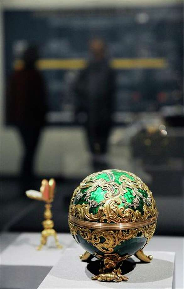 "The 1902 Kelch Rocaille Egg sits on display at the Houston Museum of Natural Science Tuesday, Feb. 19, 2013, in Houston as part of the largest private collection of items in the United States from the Russian artisan Peter Carl Faberge. The Kelch egg was created by Michael Perchin, one of Faberge's head workmasters. Featuring more than 350 objects, the exhibit ""Fabergé: A Brilliant Vision,"" runs through Dec. 31, 2013 at the Houston Museum of Natural Science. (AP Photo/Pat Sullivan) Photo: Pat Sullivan / AP"