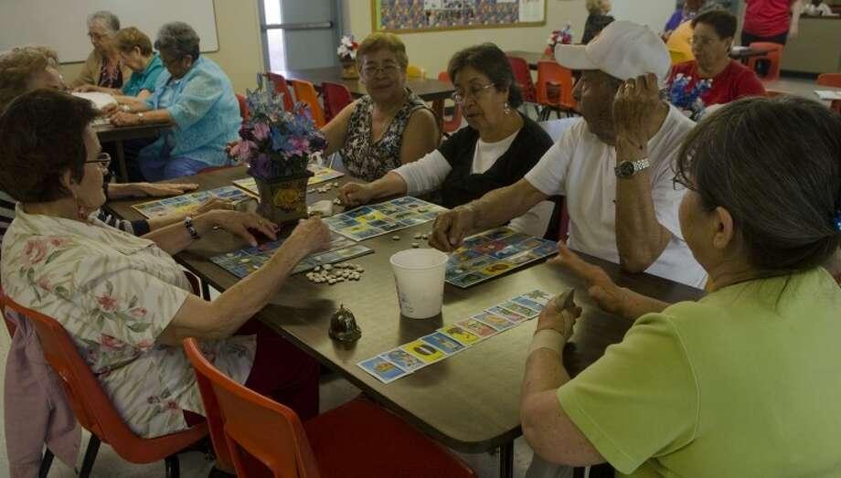 Seniors at Casa de Amigos participate in a game of la loteria, or Spanish bingo, Friday. Photo: Tim Fischer/Reporter-Telegram