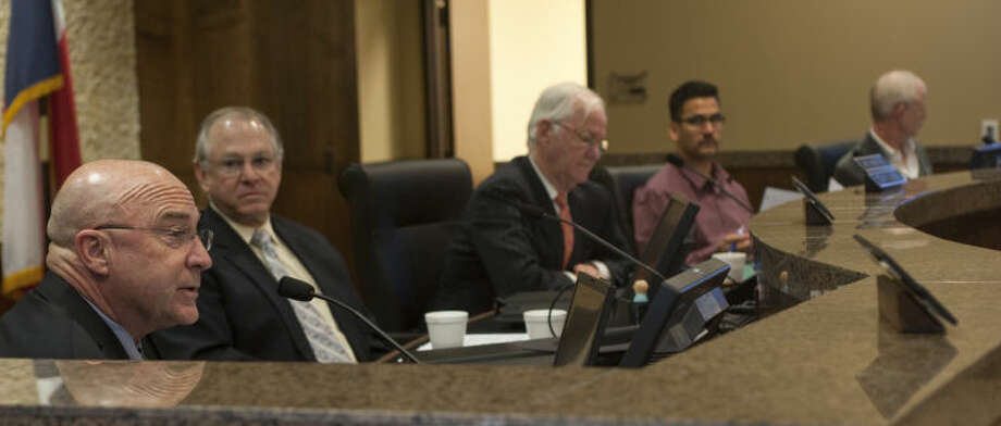 Jimmy Smith and other Midland County Commissioners unanimously approve the sale of the old courthouse to the City of Midland during a special meeting Monday morning. Tim Fischer\Reporter-Telegram Photo: Tim Fischer