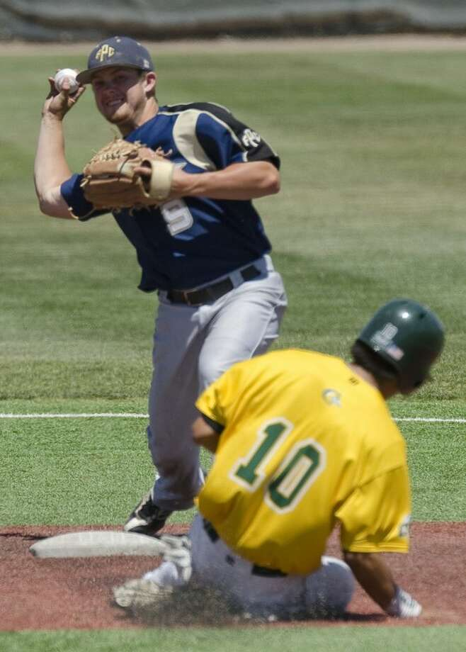 Frank Phillips' Coby Roming makes the force out at second on MC's Matt Reyes and makes the throw to first to complete the double play Saturday at Christensen Stadium. Photo by Tim Fischer/Midland Reporter-Telegram Photo: Tim Fischer